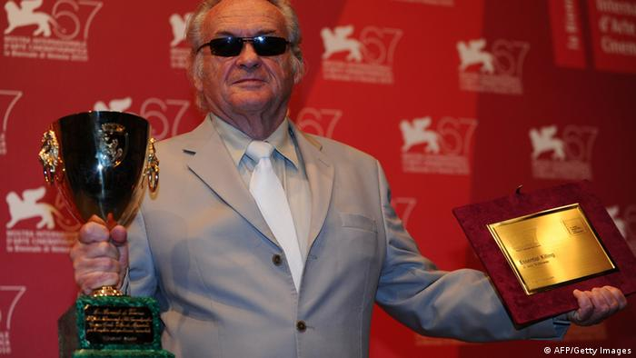 Polish film director Jerzy Skolimowski poses with the Special Prize of the jury (R) he received for his film 'Essential killing' and with the Volpi Cup he received on behalf of actor Vincent Gallo during a photocall following the awards ceremony of the 67th Venice film festival on September 11, 2010. AFP PHOTO / VINCENZO PINTO (Photo credit should read VINCENZO PINTO/AFP/Getty Images)