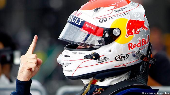 German Formula One driver Sebastian Vettel of Red Bull Racing reacts after finishing in pole position during qualifying at the Suzuka Circuit in Suzuka, western Japan, 06 October 2012.