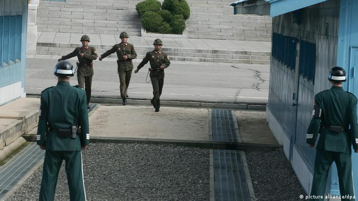 A North Korean soldiers walk at the Military Demarcation Line (Photo: EPA/KIM HEE-CHUL)