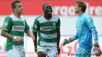 SpVgg Greuther Fürth - Hamburg SV on 06.10.2012 in theTrolli Arena in Fürth (Bayern). Gerald Asamoah, flanked by Sercan Sararer and Hamburg keeper Rene Adler, yells after a missed chance. +++(c) dpa - Bildfunk+++