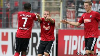 FREIBURG IM BREISGAU, GERMANY - OCTOBER 06: Cedrick Makiadi of Freiburg celebrates his first goal during the Bundesliga match between SC Freiburg and 1. FC Nuernberg at MAGE SOLAR Stadium on October 6, 2012 in Freiburg im Breisgau, Germany. (Photo by Marc Eich/Bongarts/Getty Images)