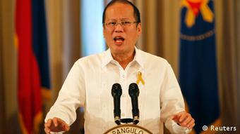 Philippine President Benigno Aquino delivers his speech on national television as his cabinet members listen, at the Malacanang palace in Manila October 7, 2012 (Photo: REUTERS/Cheryl Ravelo)