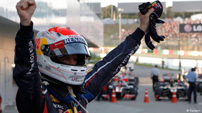 Red Bull Formula One driver Sebastian Vettel of Germany celebrates after winning the Japanese F1 Grand Prix at the Suzuka circuit October 7, 2012 (Photo: Reuters)
