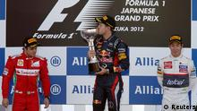 Source News Feed: EMEA Picture Service ,Germany Picture Service Red Bull Formula One driver Sebastian Vettel of Germany (C) kisses his trophy on podium next to second placed Ferrari Formula One driver Felipe Massa of Brazil (L) and thrid placed Sauber Formula One driver Kamui Kobayashi of Japan after the Japanese F1 Grand Prix at the Suzuka circuit October 7, 2012. REUTERS/Kim Kyung-Hoon (JAPAN - Tags: SPORT MOTORSPORT F1)