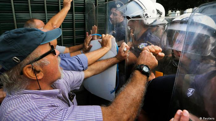 Pensioners push riot policemen during scuffles near the EU offices in Athens October 8, 2012. REUTERS/Yannis Behrakis