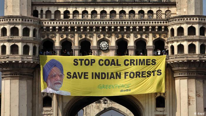 A Greenpeace banner protesting the hosting by India of the COP11 conference, atop the Charminar monument in Hyderabad,