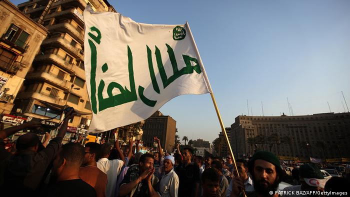 A member of the Ansar Allah (Partisans of God) Salafi group, known to have links with the al-Qaeda network, waves his movement's flag during a rally in Tahrir square PATRICK BAZ/AFP/GettyImages