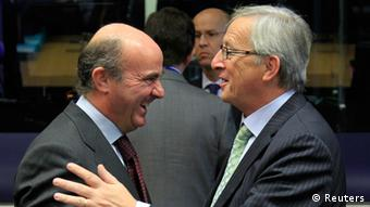 Spain's Economy Minister Luis de Guindos (L) talks with his Luxembourg counterpart Jean-Claude Juncker (R) during a meeting of the Board of Governors of the European Stability Mechanism (ESM) ahead of a eurozone finance ministers meeting in Luxembourg October 8, 2012. Euro zone finance ministers will launch their 500 billion euro permanent bailout fund on Monday, putting in place a major defence against the debt crisis that now threatens Spain. The fund, called ESM, will be used to lend to distressed euro zone sovereigns in return for strict fiscal and structural reforms that aim to put economies that have lost investor trust back on track. REUTERS/Yves Herman (BELGIUM - Tags: BUSINESS POLITICS)