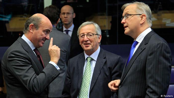 Spain's Economy Minister Luis de Guindos (L) talks with his Luxembourg counterpart Jean-Claude Juncker (C) and European Economic and Monetary Affairs Commissioner Olli Rehn (R) during a meeting of the Board of Governors of the European Stability Mechanism (ESM) ahead of an eurozone finance ministers meeting in Luxembourg October 8, 2012. Euro zone finance ministers will launch their 500 billion euro permanent bailout fund on Monday, putting in place a major defence against the debt crisis that now threatens Spain. The fund, called ESM, will be used to lend to distressed euro zone sovereigns in return for strict fiscal and structural reforms that aim to put economies that have lost investor trust back on track. REUTERS