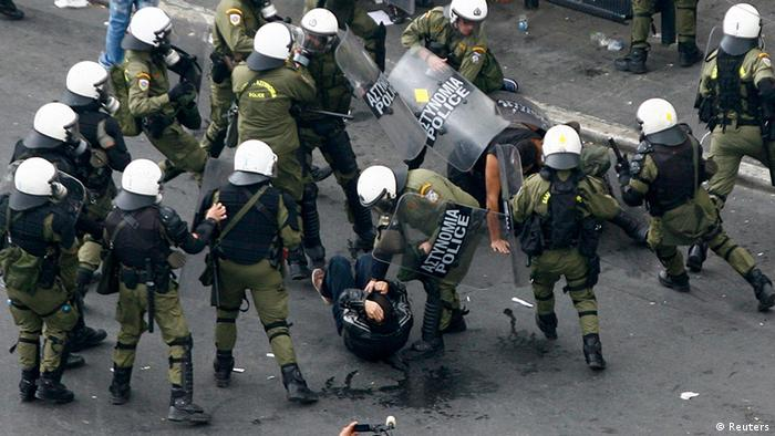 Greek demonstrators are arrested by riot policemen Photo: REUTERS/Grigoris Siamidis
