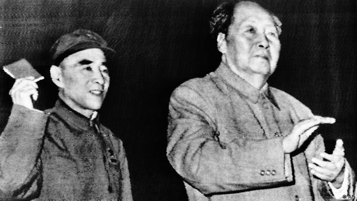 Communist China Chairman Mao Tse-Tung his chosen successor, Lin Piao, at People's Liberation Army reception in the Great Hall of the People in Peking Tuesday, October 1969. Lin waves a book of Mao quotations. (AP Photo)