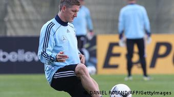 German national football team's midfielder Bastian Schweinsteiger dribbles with the ball during a training session in Frankfurt am Main, on October 9, 2012 ahead of World Cup 2014 qualifiers. AFP PHOTO / DANIEL ROLAND (Photo credit should read DANIEL ROLAND/AFP/GettyImages)