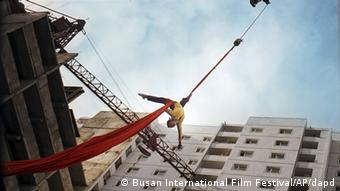 Han Jong-sim, who plays the title character, is winched into the sky (Photo: AP/dapd)