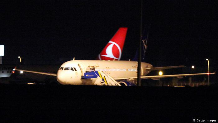 A Syrian passenger plane is seen after it was forced to land at Ankara airport on October 10, 2012. A Syrian passenger plane was forced to land in Ankara on Wednesday evening on suspicions that it was carrying weapons, Anatolia news agency reported citing officials. AFP PHOTO/ADEM ALTAN (Photo credit should read ADEM ALTAN/AFP/GettyImages)