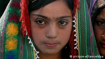 A 12 year old Afghan bride during the wedding ceremony in Herat on Sunday 25 December 2005.