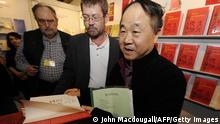 Chinese author Mo Yan autographs his book before taking part in a reading at the 61st Frankfurt Book Fair in Frankfurt October 15, 2009, where China is this year's guest of honour. Some 6,900 exhibitors from around 100 countries are to gather in Frankfurt until October 18. AFP PHOTO JOHN MACDOUGALL (Photo credit should read JOHN MACDOUGALL/AFP/Getty Images)