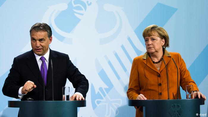 German Chancellor Angela Merkel, right, and Hungarian Prime Minister Viktor Orban brief the media after talks at the chancellery in Berlin, Thursday, Oct. 11, 2012. (AP: Photo/Markus Schreiber)