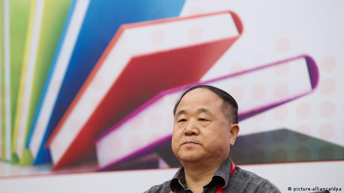 --FILE--Chinese author and writer Mo Yan attends a reading forum during the Shanghai Book Fair in Shanghai, China, 15 August 2012. This year, two hot candidates for the Nobel Literature Prize are Chinese writer Mo Yan and Japanese writer Haruki Murakami. Alia from Off-beat China tracked the discussion online and found out that Chinese netizens have voted against Mo Yan.