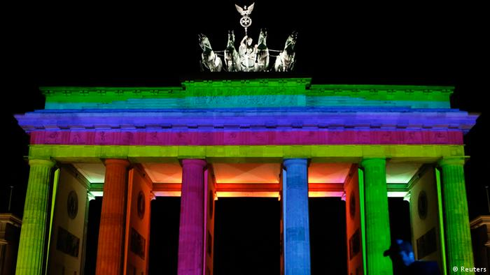 The Brandenburg Gate is illuminated during a technical check for the Festival of Lights in Berlin on October 9, 2012.