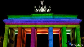 The Brandenburg Gate is illuminated during a technical check for the Festival of Lights in Berlin