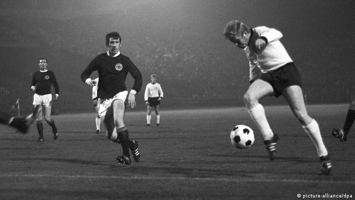 Haller (on the ball) in action during a 1969 World Cup qualifier against Scotland, relatively late in his international career. (Photo: dpa)