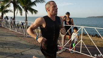 Lance Armstrong competes in the Ironman Panama 70.3. triathlon in Panama City (AP Photo: Arnulfo Franco)