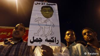 Protesters shout slogans against general prosecutor Abdel Maguid Mahmoud and members of the Mubarak regime at Tahrir Square