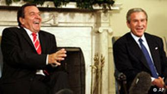 Gerhard Schröder and George W. Bush share a laugh in the Oval Office