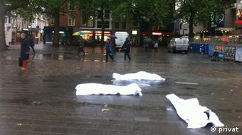 A flashmob uses body bags to protest in the Netherlands