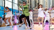 South Korean rapper Psy performs his massive K-pop hit Gangnam Style live on NBC's Today show, Friday, Sept. 14, 2012, in New York. (Photo by Jason DeCrow/Invision/AP Images)