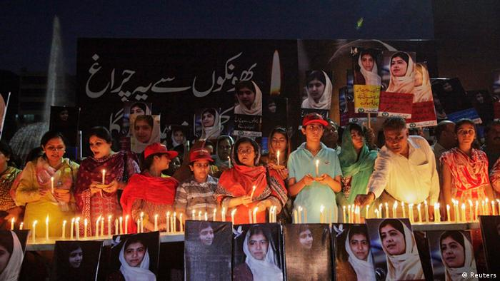 Source News Feed: EMEA Picture Service ,Germany Picture Service People light candles alongside pictures of Malala Yousufzai, who was shot on Tuesday by the Taliban for speaking out against the militants and promoting education for girls, at a school in Lahore October 12, 2012. One of the Taliban's most feared commanders, Maulana Fazlullah, carefully briefed two killers from his special hit squad on their next target -- 14-year-old Pakistani schoolgirl Yousufzai, who had angered the Taliban by speaking out for Western-style girls' education. Shot in the head and the neck, Yousufzai still lies unconscious in hospital. REUTERS/Mohsin Raza (PAKISTAN - Tags: POLITICS CIVIL UNREST EDUCATION CRIME LAW)