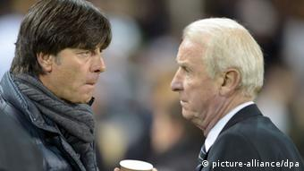 Germany's coach Joachim Loew (L) talks to Ireland's coach Giovanni Trapattoni