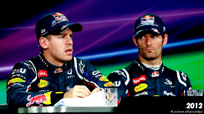 epa03431390 German Formula One driver Sebastian Vettel of Red Bull Racing speaks as his teammate Australian Formula One driver Mark Webber looks during a press conference following the qualifying session at the Korean International Circuit in Yeongam, South Korea, 13 October 2012. EPA/JEON HEON-KYUN