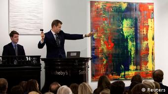 An auctioneer directs bidding for the sale of Gerhard Richter's Abstraktes Bild (809-4), from the collection of musician Eric Clapton, at Sotheby's auction house in London in this picture taken October 12, 2012, and made available to Reuters on October 13, 2012. Sotheby's said the painting sold at auction on October 12 for 21.3 million pounds ($34.2 million). REUTERS/Sotheby's/Handout (BRITAIN - Tags: ENTERTAINMENT BUSINESS) NO SALES. NO ARCHIVES. FOR EDITORIAL USE ONLY. NOT FOR SALE FOR MARKETING OR ADVERTISING CAMPAIGNS. THIS IMAGE HAS BEEN SUPPLIED BY A THIRD PARTY. IT IS DISTRIBUTED, EXACTLY AS RECEIVED BY REUTERS, AS A SERVICE TO CLIENTS
