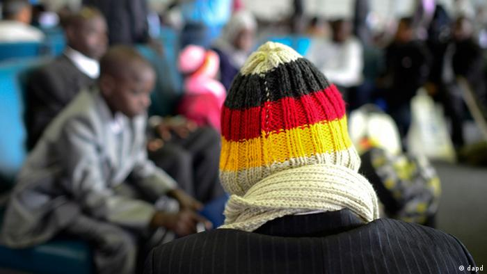 A refugee waits at Hanover airport, shortly after his arrival. (Copyright: Nigel Treblin/dapd)