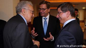 German Foreign Minister Guido Westerwelle with Turkish Foreign Minister Ahmet Davutoglu and the UN's peace envoy to Syria Lakhdar Brahimi EPA/HAKAN GOKTEPE/ANADOLU AGENCY +++(c) dpa - Bildfunk+++