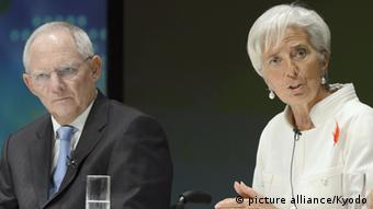 International Monetary Fund Managing Director Christine Lagarde (R) speaks during a debate session in Tokyo. To the left is German Finance Minister Wolfgang Schaeuble. Photo: picture alliance/Kyodo