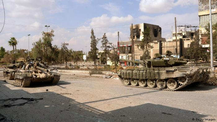 Syrian armoured vehicles parked in Karm al-Gabal neighbourhood of Syria's northern city of Aleppo on October 9, 2012. Photo: AFP/GettyImages