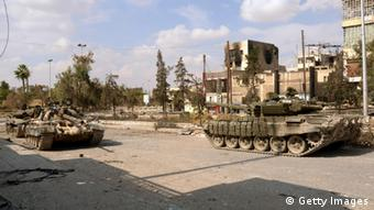 A unit of the Syrian armed forces carry out a military operation in Aleppo AFP/GettyImages