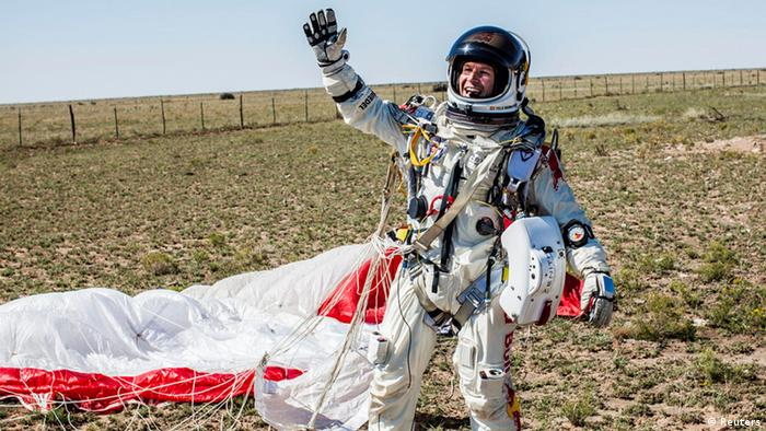 Pilot Felix Baumgartner of Austria celebrates after successfully completing the final manned flight for Red Bull Stratos in Roswell, New Mexico, in this October 14, 2012 handout photo. An Austrian daredevil leapt into the stratosphere from a balloon hovering near the edge of space 24 miles (38 km) above Earth on Sunday, breaking as many as three world records including the highest skydive ever, project sponsors said.