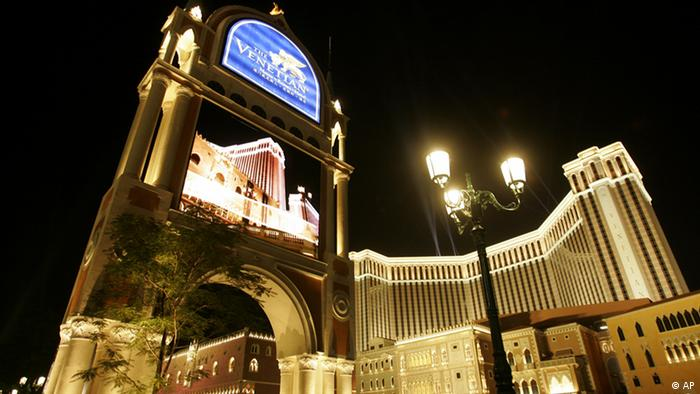 FILE - In this Aug. 28, 2007 file photo, the Venetian Macao Resort Hotel is shown in Macau. Las Vegas Sands Corp., the U.S. gambling company controlled by billionaire Sheldon Adelson, which owned the Venetian resort, is being sued for $375 million in a Macau court over the way it won a lucrative gaming license in the Asian casino hub. (AP Photo/Kin Cheung, File)