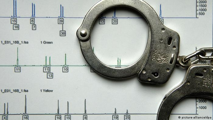 Handcuffs and a DNA analysis printout