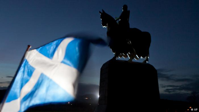 A Scottish Saltire flag blows in the wind near the statue of Scottish King Robert the Bruce, at Bannockburn, Scotland, Thursday, Jan. 12, 2012. The monument commemorates Robert the Bruce whose army defeated the English army in 1314. This week the Scottish Government has announced that they wish to hold an independence referendum in 2014. (AP Photo / Chris Clark)