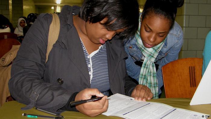 US student Jasmine fills out a voter registration form