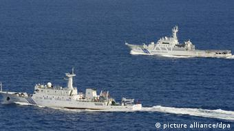 Photo from a Kyodo News aircraft shows the Chinese marine surveillance ship Haijian 51 (front) in Japanese territorial waters near the Japan-controlled Senkaku Islands in the East China Sea on Sept. 14, 2012