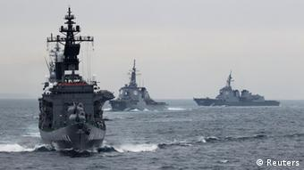 Japanese Maritime Self-Defense Force (MSDF) destroyer Kurama (L), which is carrying Japan's Prime Minister Yoshihiko Noda, leads the MSDF fleet during a naval fleet review at Sagami Bay, off Yokosuka, south of Tokyo October 14, 2012 (Photo: REUTERS/Yuriko Nakao)