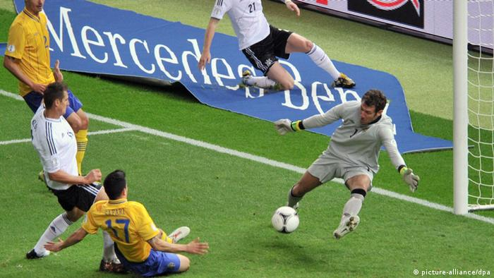 Germany's Miroslav Klose (L) slams the ball into the net