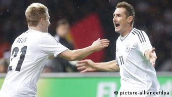 Germany's Miroslav Klose celebrates with team mate Marco Reus