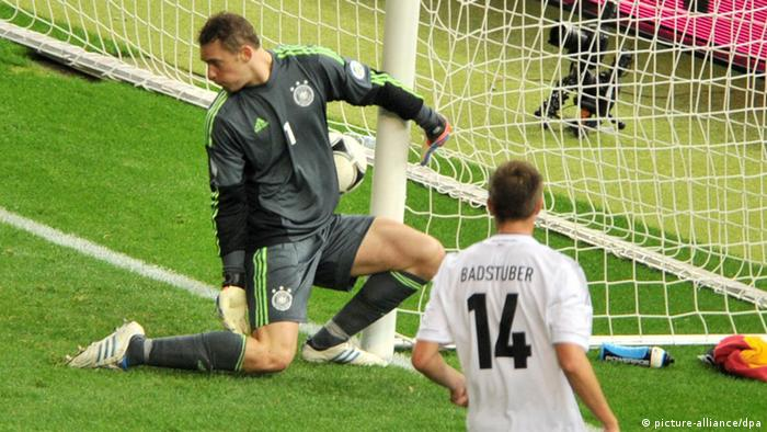 Sweden's Mikael Lustig (R) scores the 4-2 goal against Germany's goalkeeper Manuel Neuner during the FIFA World Cup 2014 qualifying soccer match between Germany and Sweden at Olympic stadium in Berlin, Germany, 16 October 2012. Photo: Hannibal/dpa