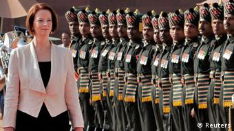 Australia's Prime Minister Julia Gillard (L) inspects a guard of honour during her ceremonial reception at the forecourt of India's Rashtrapati Bhavan presidential palace in New Delhi October 17, 2012. Gillard is on a three-day state visit to India. REUTERS/B Mathur (INDIA - Tags: POLITICS)
